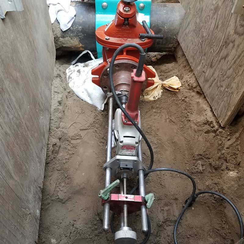 Warner Bros Studios 4inch Hot Tap on 10inch Sch. 40 Steel Chilled Water Line under 150 psi