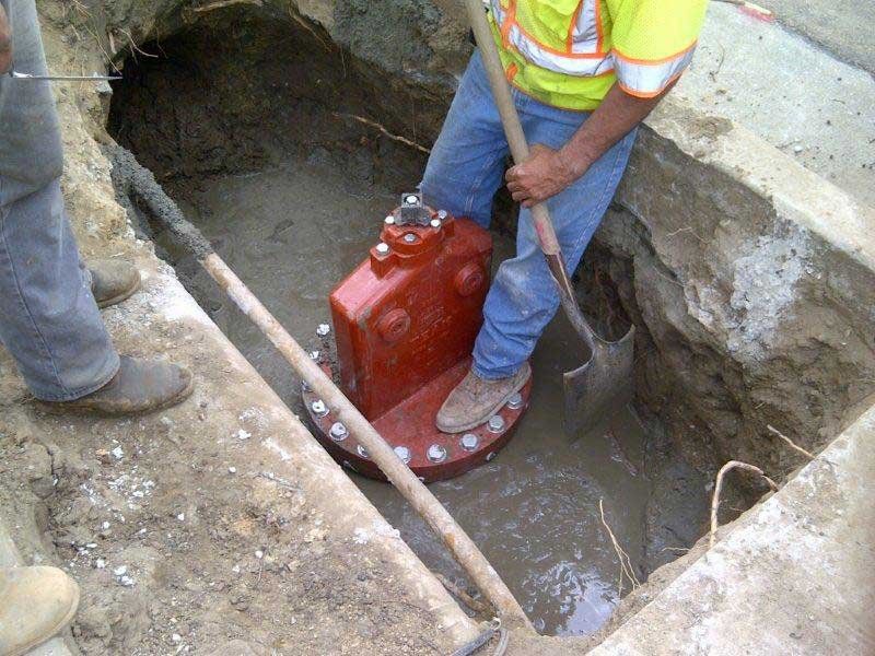 Concrete is evened out over the top of the pipeline and bottom of the Insert Valve