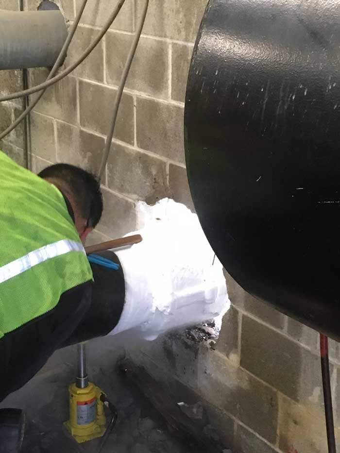 "10"" Pipe Freeze Plug in a Tight Location Half Outside and Inside in Houston, TX"