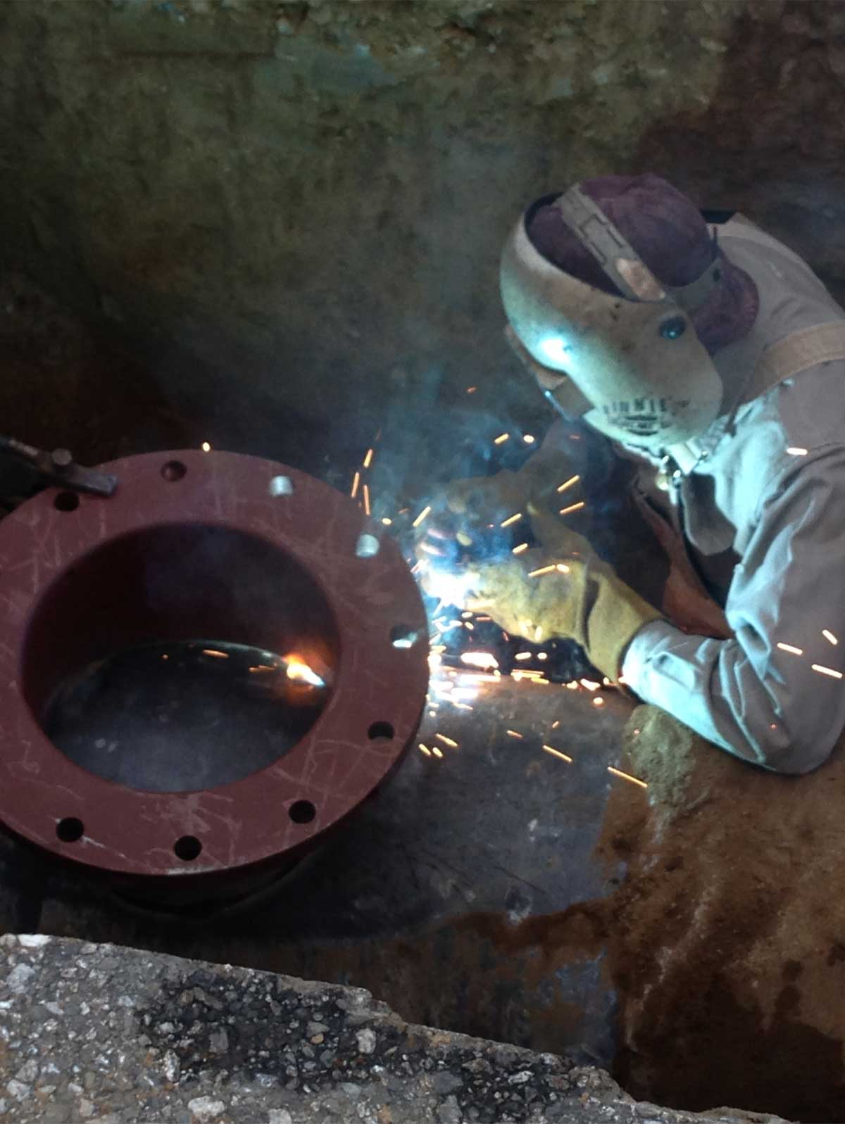 Welder is welding a 12inch Flange of CMLC Pipeline